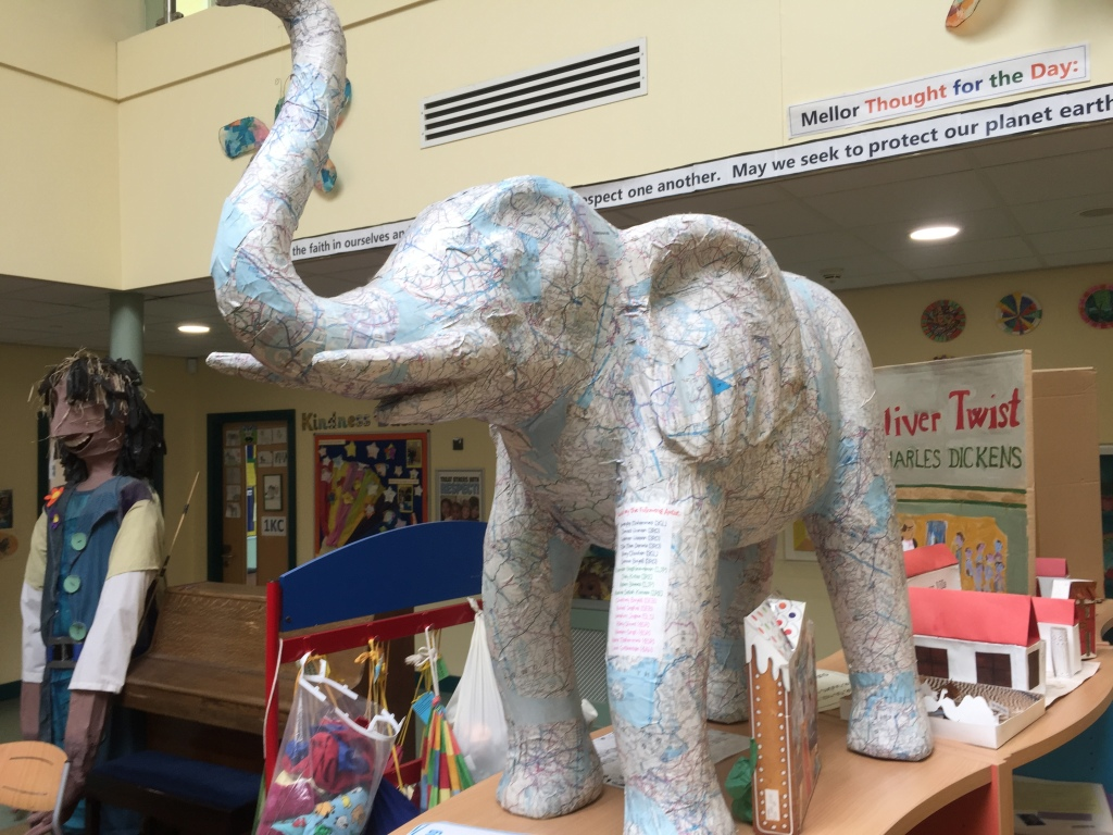 Bel Giant figure and map covered elephant